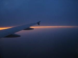 photo of sunset through airplane window