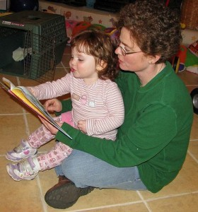 image of adult reading to child