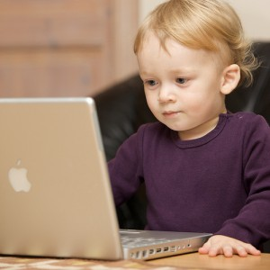 image of a child at a computer